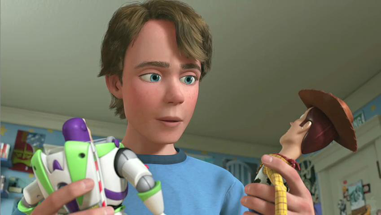 A picture of 18 year old Andy with Woody and Buzz from Toy Story 3