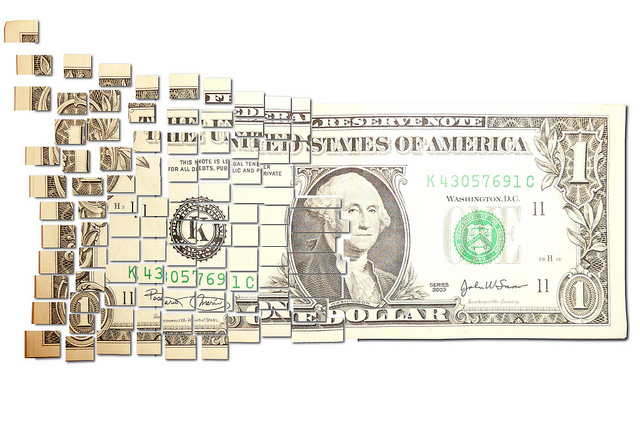 A picture of a dollar bill cut up into pieces