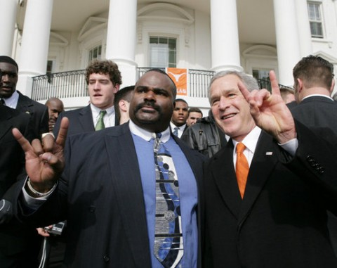George W. Bush throws up the Hook 'em Horns with Jeff Madden in support of the 2005-06 Texas Longhorn National Champions
